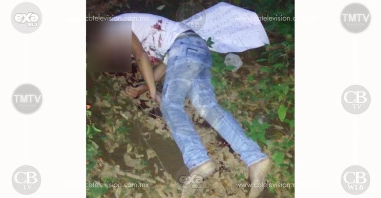 Abandonan cadáver con un disparo en la cabeza y una cartulina con mensaje