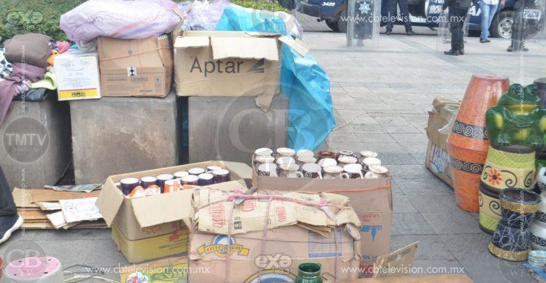 Luego de una serie de forcejeos se desaloja Plaza Melchor Ocampo