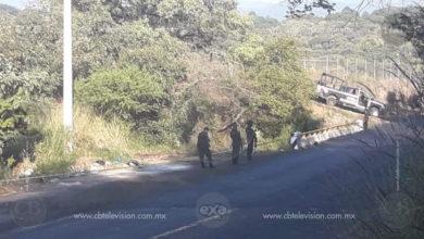 Encuentran cadáver abandonado en la carretera con lesiones de bala
