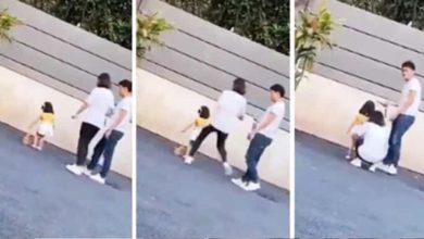 Captan a una madre pateando a su pequeña hija por no posar para una foto