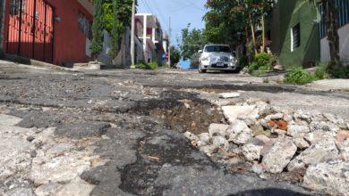 Photo of Baches en calle Kenia: un riesgo al caminar, afirman vecinos.